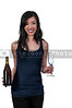 Beautiful Asian woman holding a wine bottle and glasses