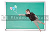 Handsome young boy floating with balloons on a chalkboard