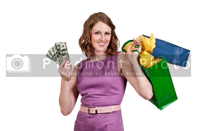 Beautiful woman holding a hand full of 100 dollar bills