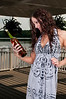 Beautiful woman holding a bottle of wine