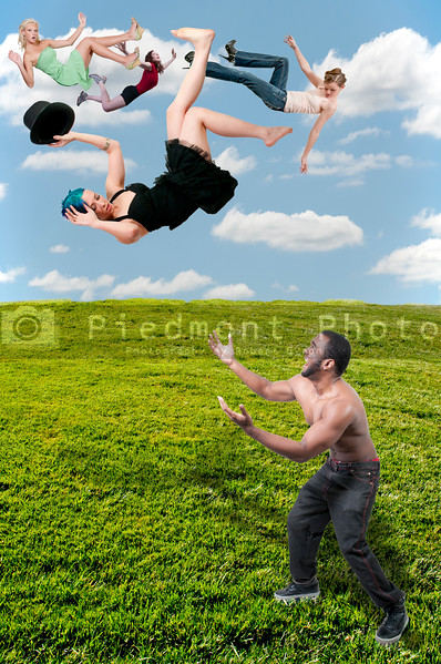 Handsome man catching a beautiful young woman falling through the sky