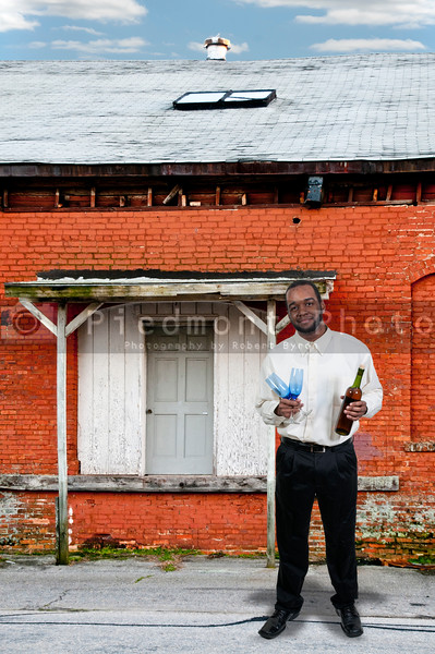 Black African American man wine glass and bottles of red wine.