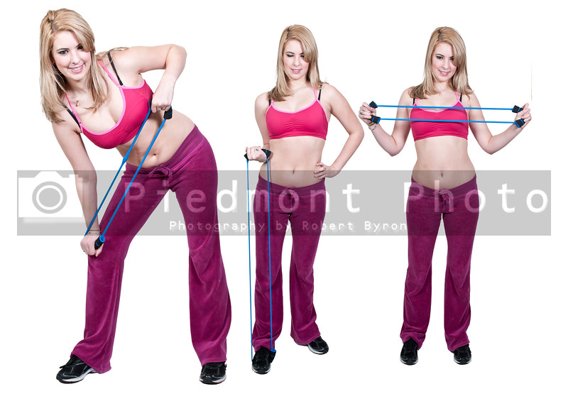 Beautiful young women working out with resistance band tubes