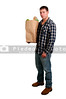 Handsome man grocery shopping holding a brown paper bag