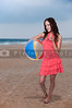 A beautiful young woman holding a beachball