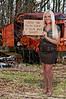 A beautiful young woman holding up aninspirational sign