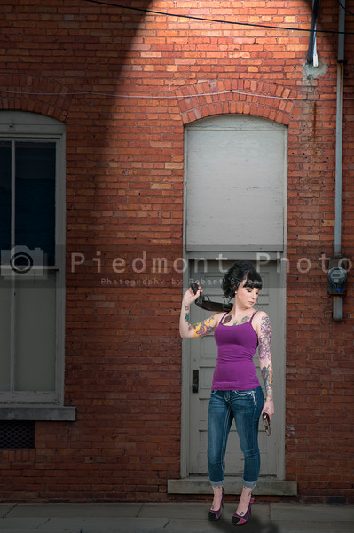 Woman with shotgun