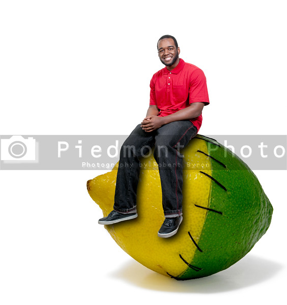 Black African American American man sitting on a lemon and a lime stitched together