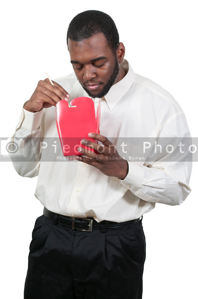 Black African American man eating Chinese or Japanese Asian food