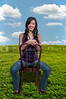 Beautiful young Asian woman sitting in a chair