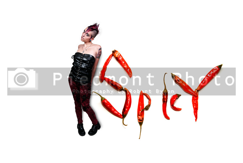 Hot and spicy peppers with a hot and spicy woman