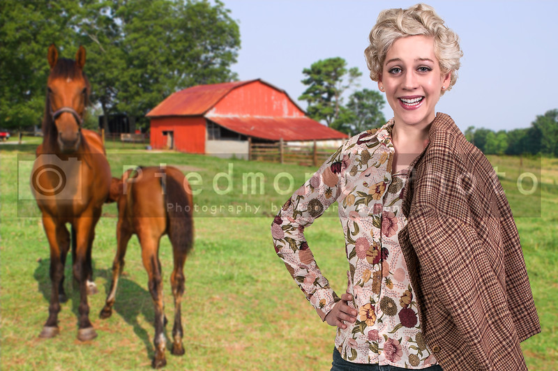 Beautiful woman standing next to a horse