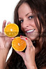 Beautiful woman holding fresh orange slices