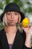 Woman Holding Lemon