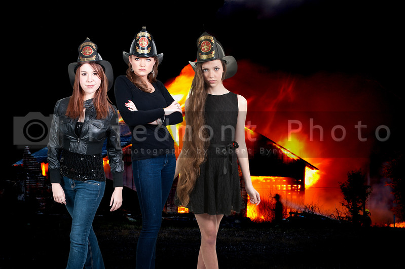 Beautiful women firefighters at a blazing fire