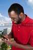 Black African American man using a cell phone for texting