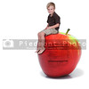 Handsome little boy sitting on a green apple with a nutrition label