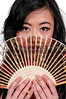 Beautiful woman holding a traditional oriental fan
