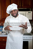 Black African American male chef holding a takeout box
