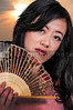 Beautiful Asian woman with an oriental fan