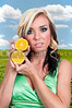Beautiful woman holding fresh orange slices