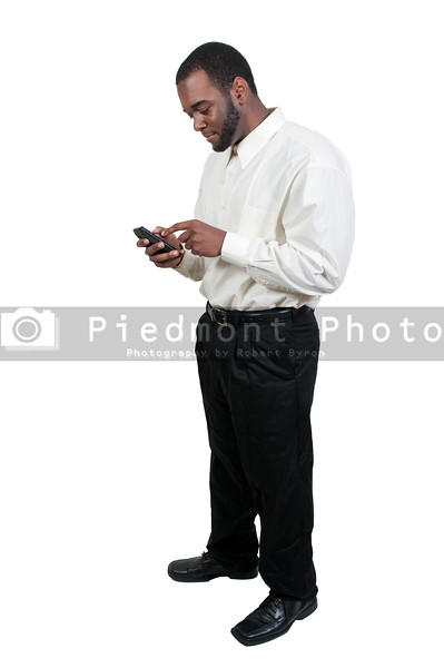 Black African American business man using a cell phone for texting