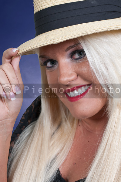 Beautiful young woman in a fedora hat