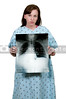 A beautiful female patient holding a chest x-ray