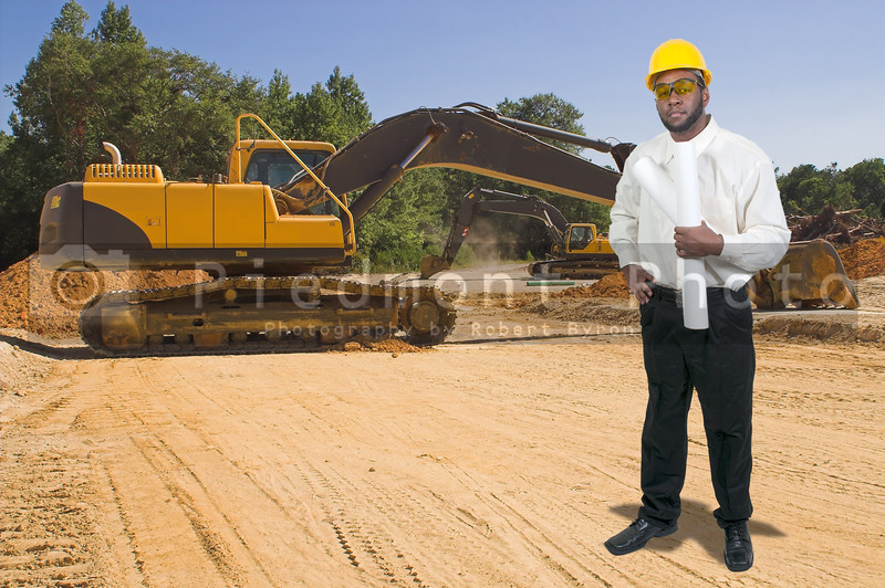 Balck African American male construction worker a job site with a backhoe