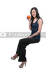 Beautiful young woman sitting on an orange