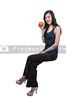Beautiful young woman sitting on an orange