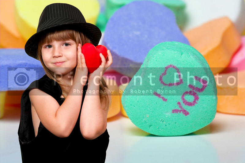 Little girl with conversation hearts Valentines day candy