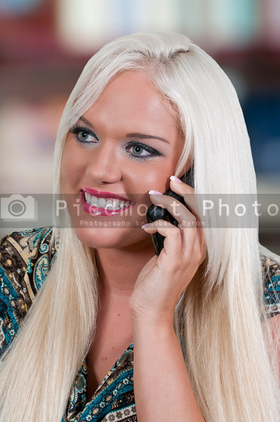 Beautiful young woman talking on a phone
