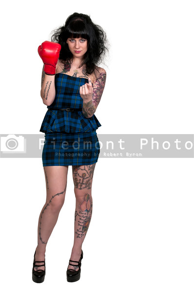 A beautiful woman in wearing a boxing glove in front of a broken heart - heartbreaker