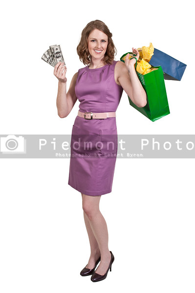 Beautiful woman shopper holding a hand full of 100 dollar bills