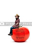 Beautiful woman sitting on a red ripe tomato