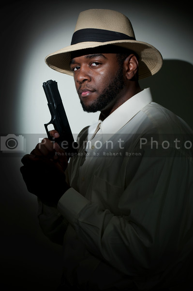 Black African American police private detective man on the job with a gun