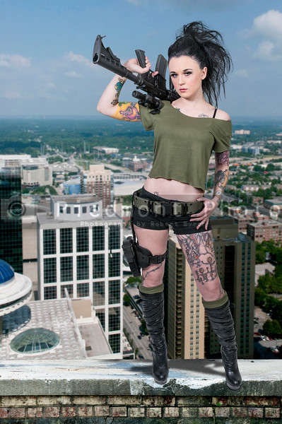 Tattooed Woman with Assault Rifle