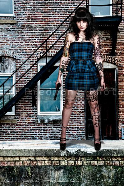 Tattooed Woman with Pistol