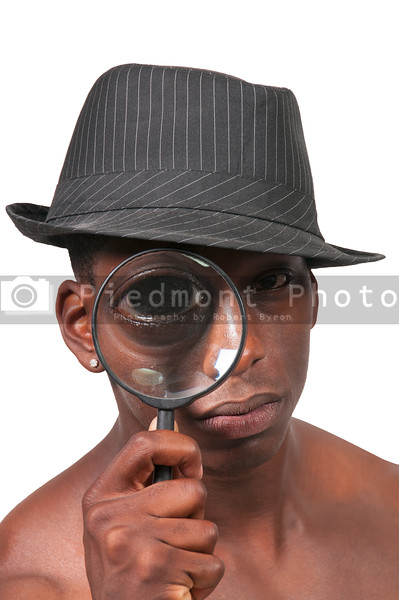 Black Man Looking through a magnifying glass