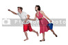 Couple running with a sand pail