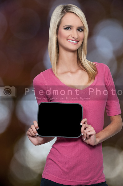 Woman Holding a Blank Sign