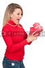 Beautiful woman opening a present