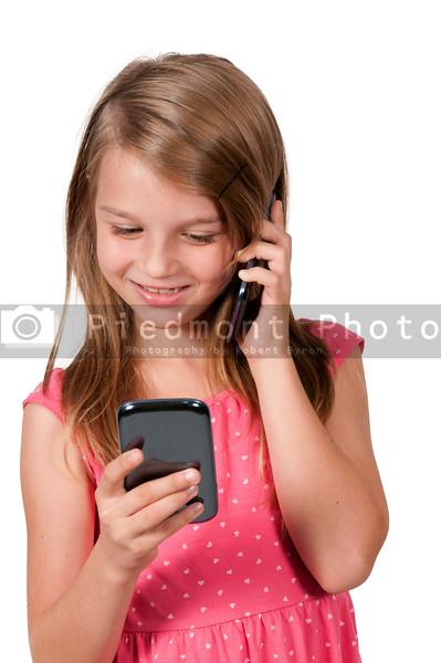 Little Girl Using Cell Phones