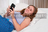 Woman Texting in Bed
