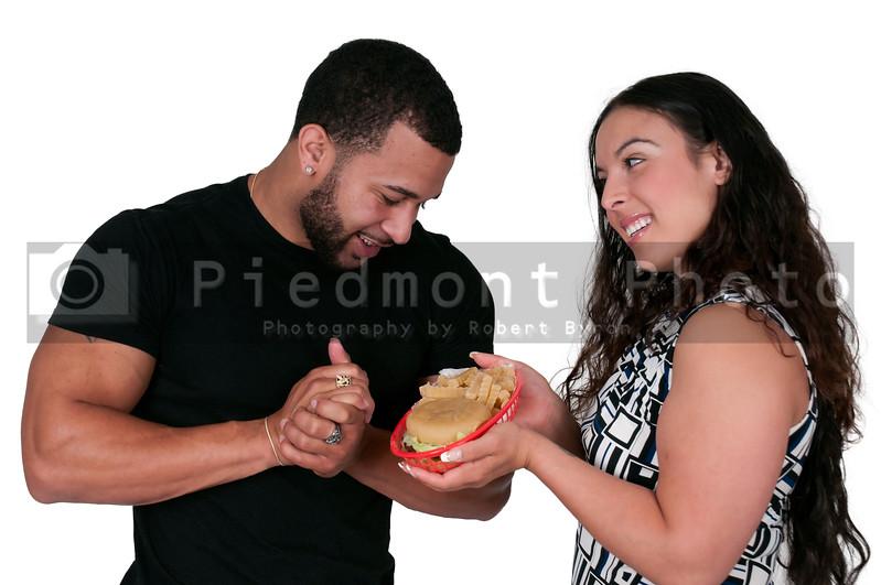 Woman Giving Hamburger to a Man