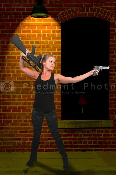 Woman with Assault Rifle and Handgun