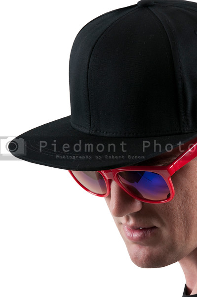 Man wearing baseball cap and sunglasses