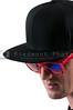 Man wearing baseball cap and sunglasses