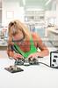 Woman soldering